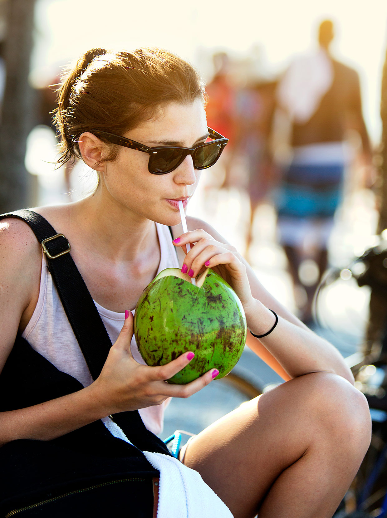 woman-drinking-from-coconut