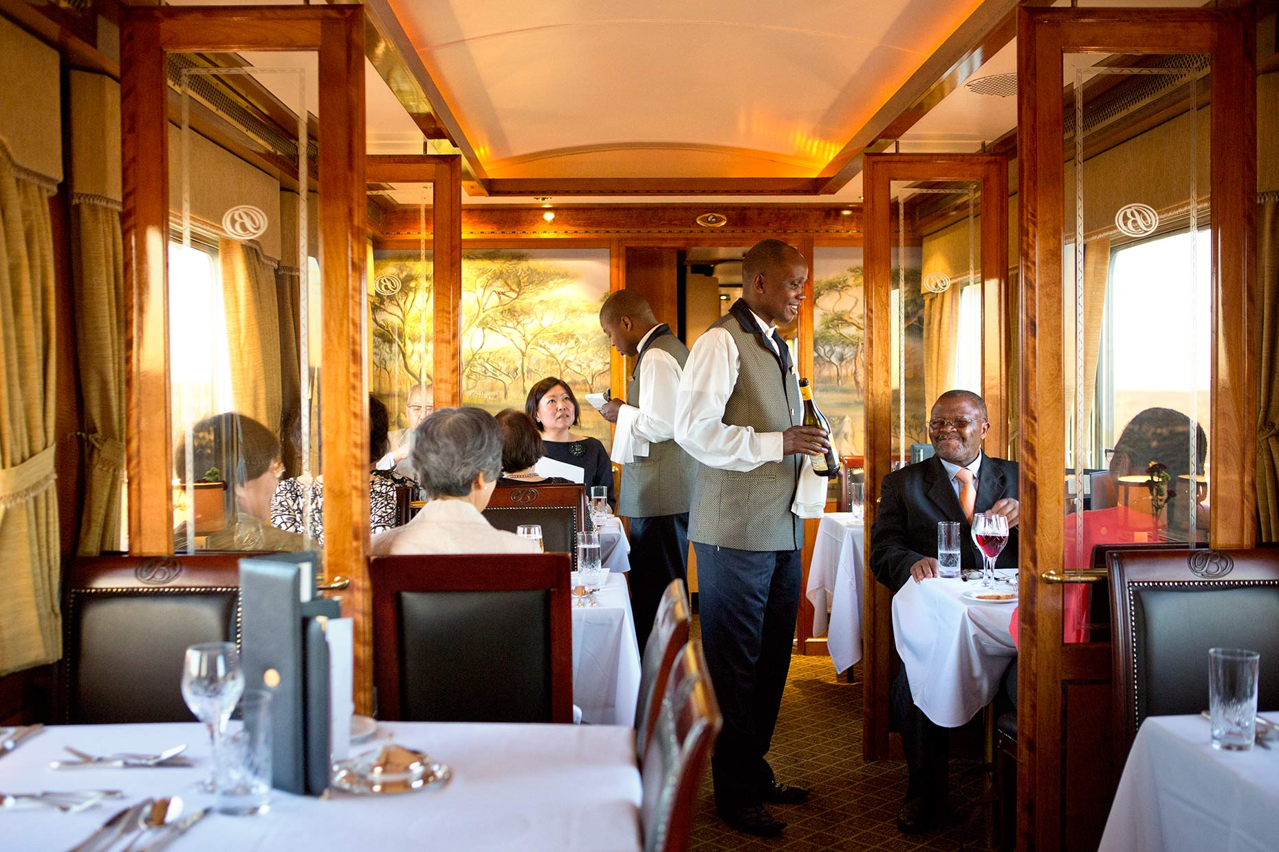 waiter serving diners on the Blue Train in South africa