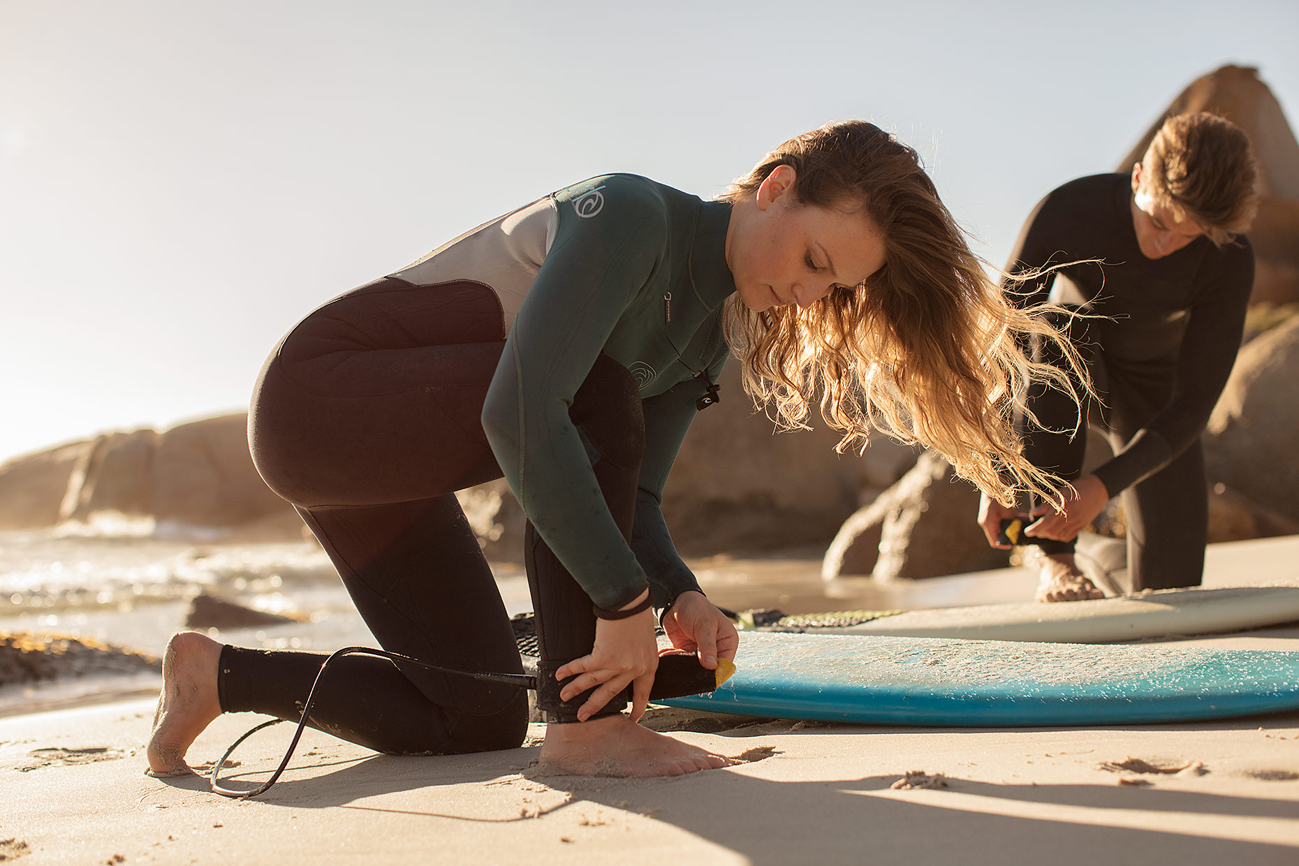 Female surfer preparing to surf