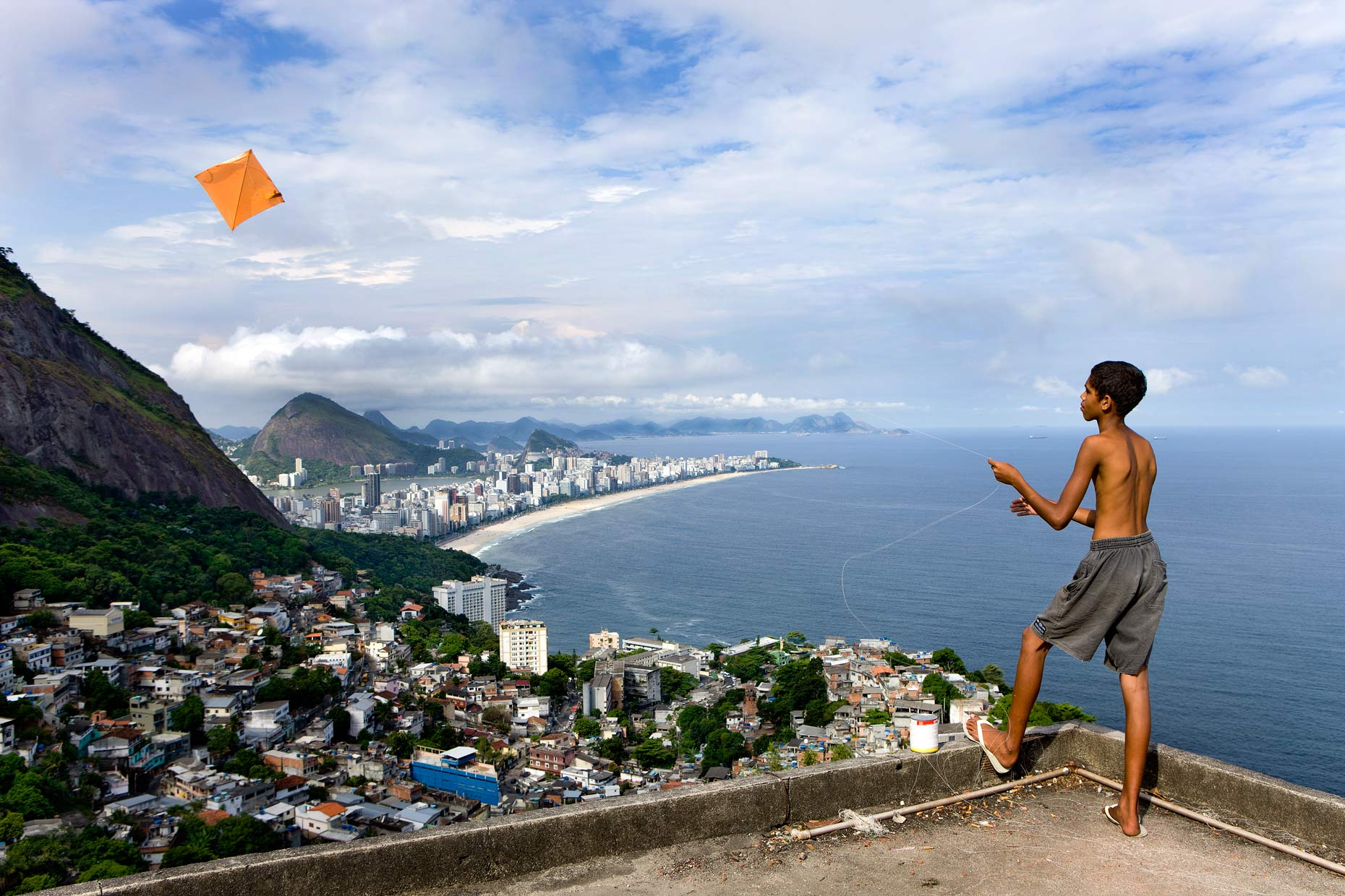 boy-on-roof-in-vidigal-favela