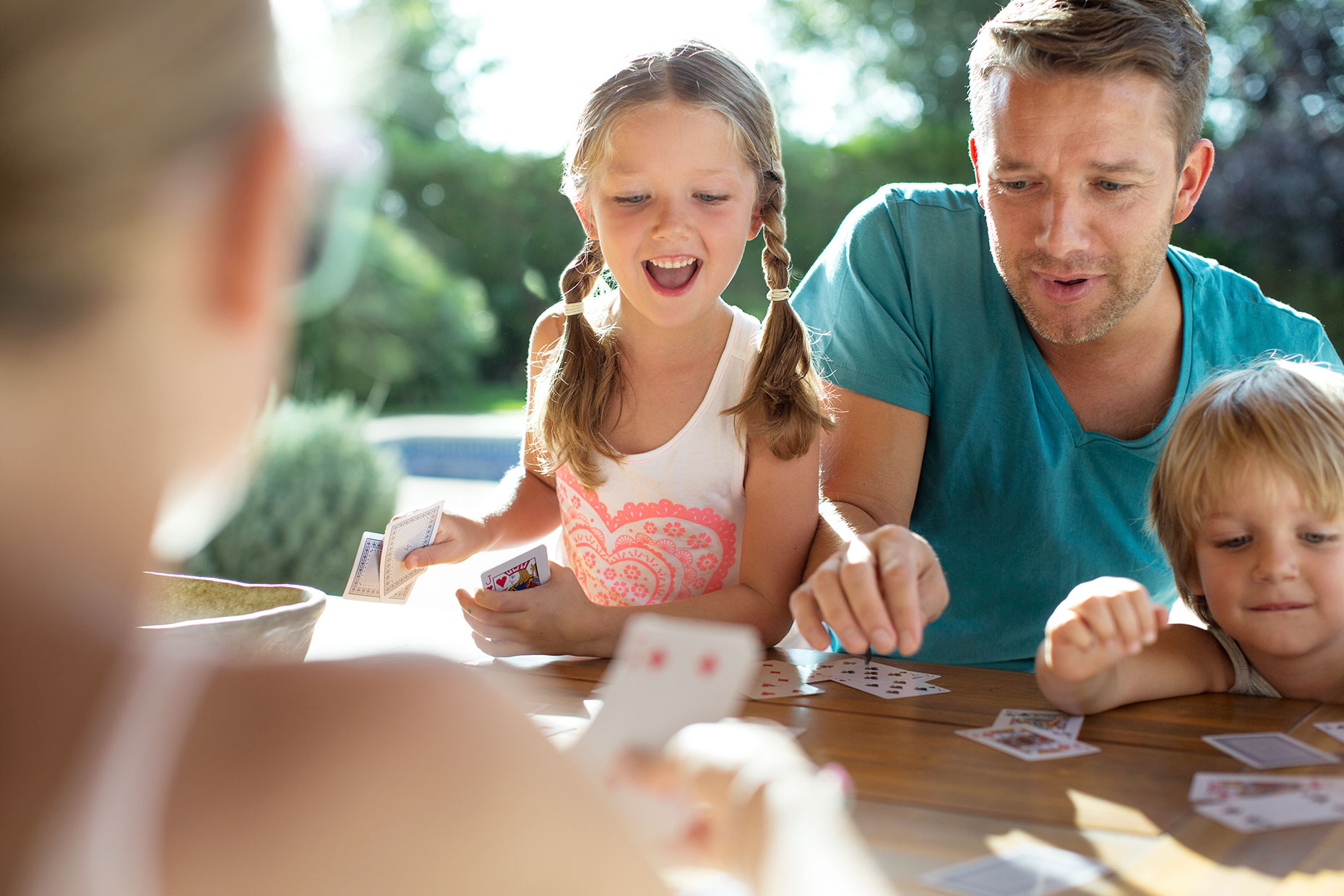 family-around-table-playing-cards