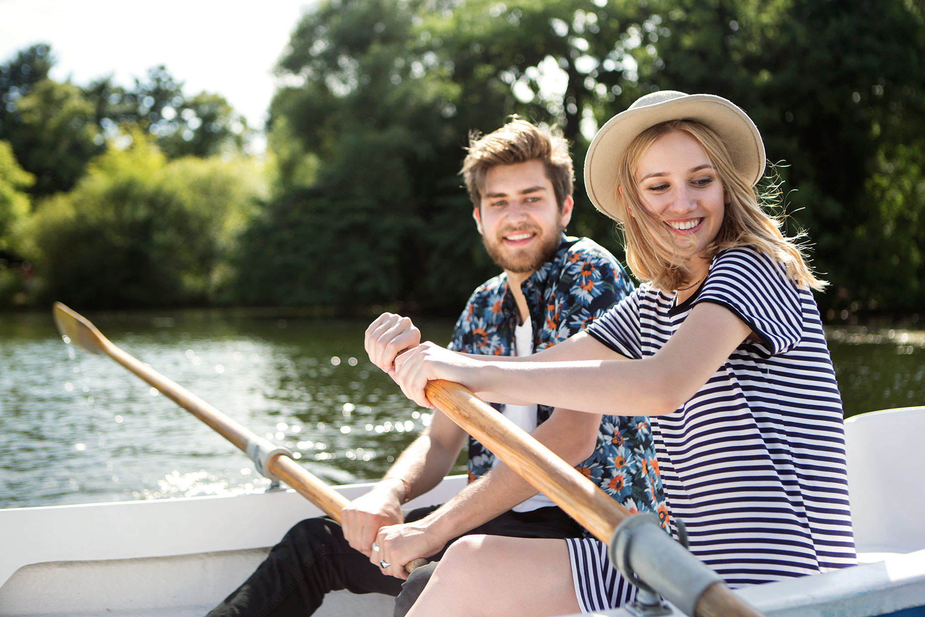 guy-and-girl-rowing-on-lake