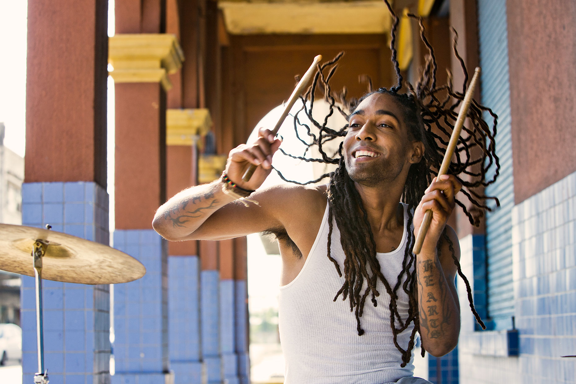 man-with-dreadlocks-drumming